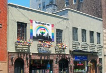 "Stonewall Inn 2012 with gay-pride flags and banner"" by Daniel Case - Own work"