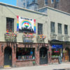 """Stonewall Inn 2012 with gay-pride flags and banner"""" by Daniel Case - Own work"""